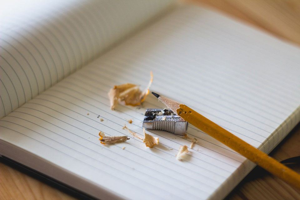 Pencil and shavings on a lined notebook