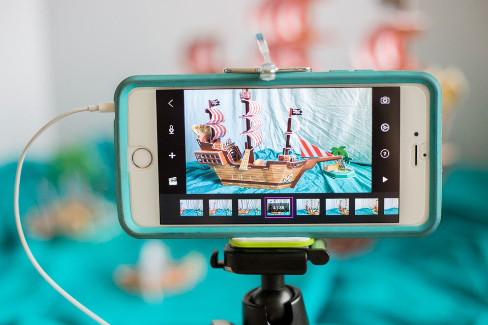 iphone on a tripod with a photo of a pirate ship in still frame