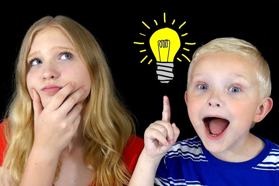 Two children, one thinking the other pointing to a cartoon light bulb