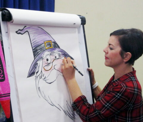 Liz Million drawing a wizard