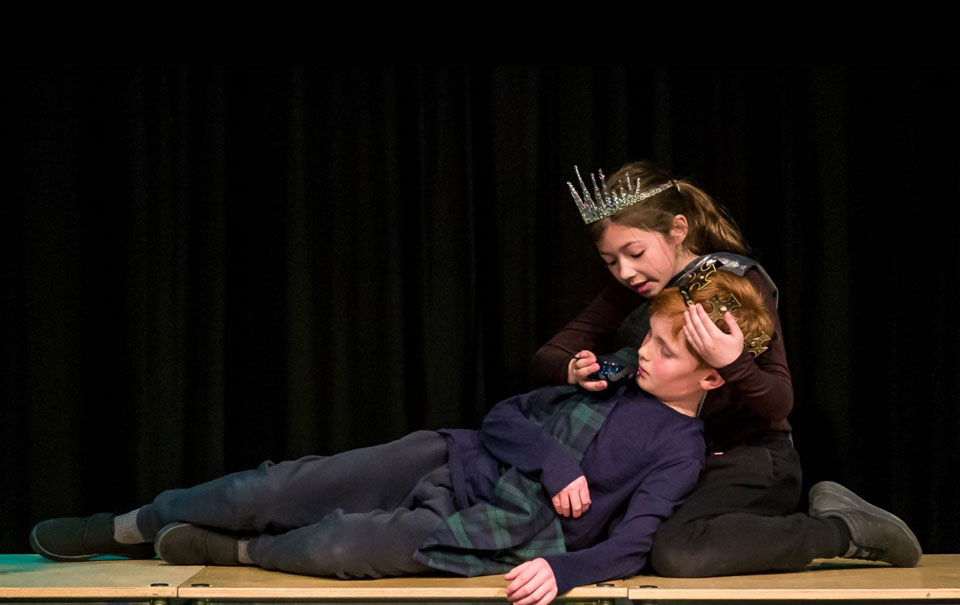 Two young people acting a scene from midsummer nights dream