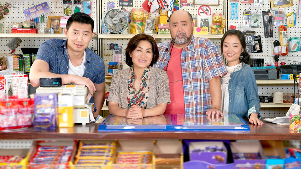 Asian family behind the counter in a convenience store