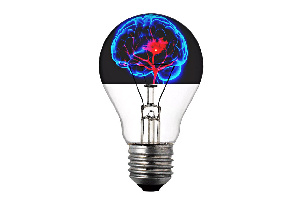 Light bulb with a brain in the middle where the filament goes