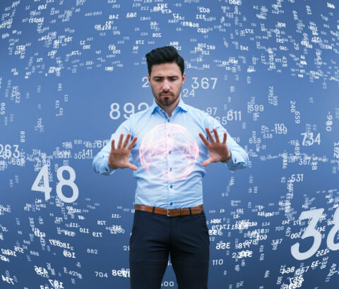 Man standing in the middle of whirling numbers