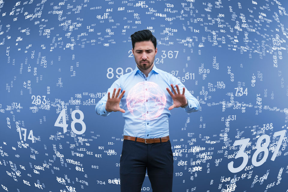 Man standing in the middle of swirling numbers