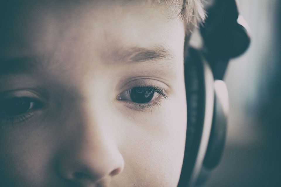 Child wearing headphones looking puzzled